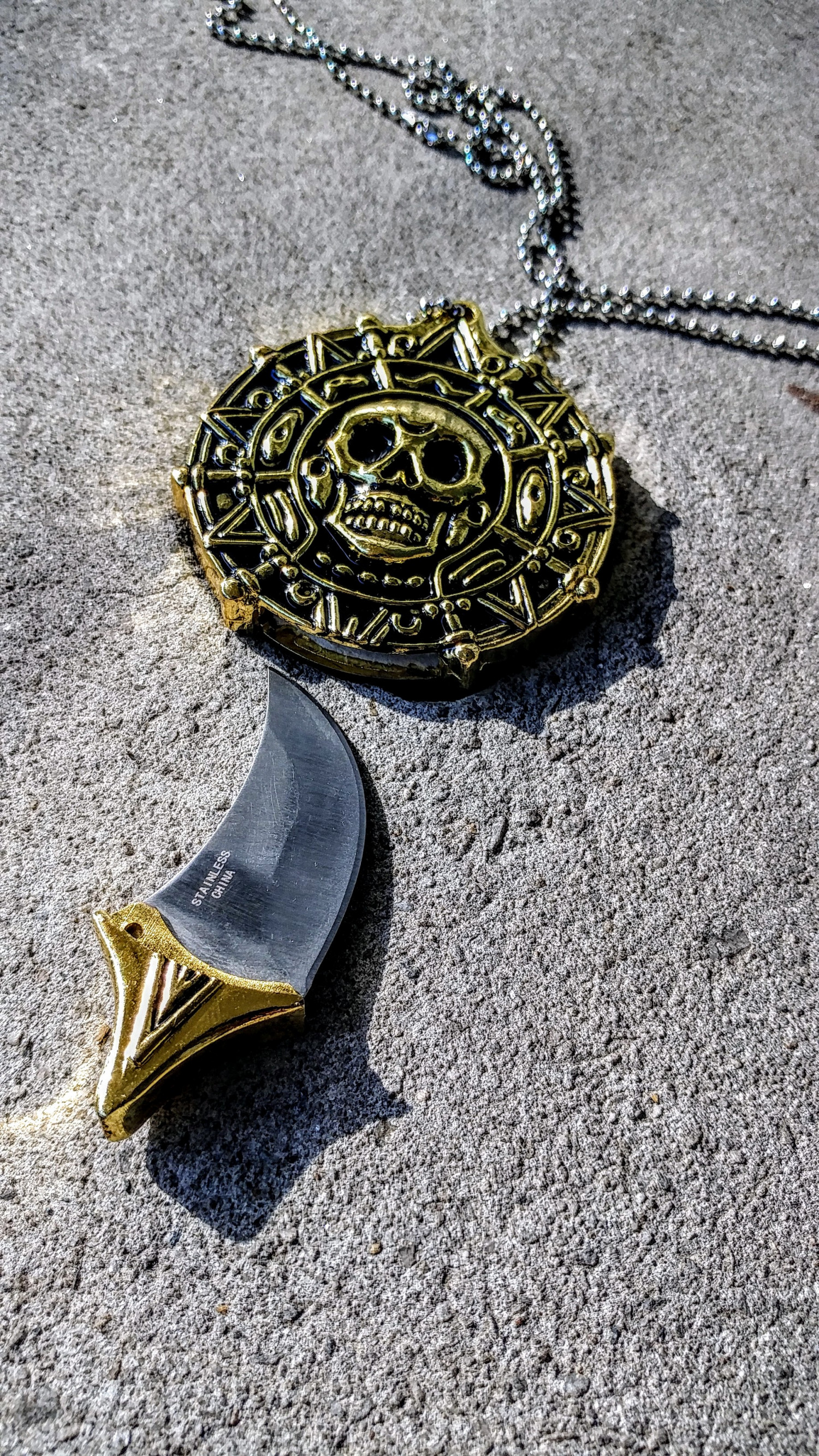 Pirate Pendant with Hidden Knife Infographic