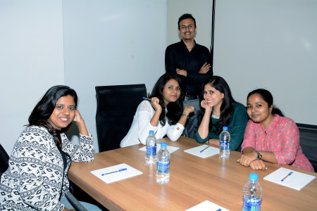 Our business team posing after a knowledge sharing session Infographic